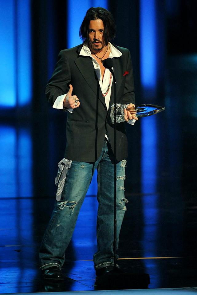 "Also appearing at the People's Choice Awards was a casually-dressed Johnny Depp, who walked home with two awards: Favorite Movie Actor and Actor of the Decade. Alberto E. Rodriguez/<a href=""http://www.wireimage.com"" target=""new"">WireImage.com</a> - January 6, 2010"