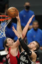 Los Angeles Clippers center Ivica Zubac, right, shoots as Houston Rockets forward Kelly Olynyk defends during the first half of an NBA basketball game Friday, April 9, 2021, in Los Angeles. (AP Photo/Mark J. Terrill)