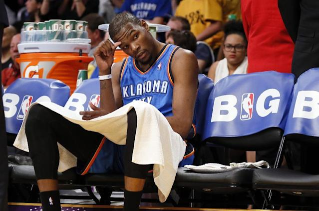 Oklahoma City Thunder forward Kevin Durant sits down on the bench as his team trails the Los Angeles Lakers after the third quarter of an NBA basketball game in Los Angeles, Sunday, March 9, 2014. The Lakers won 114-110. (AP Photo/Danny Moloshok)
