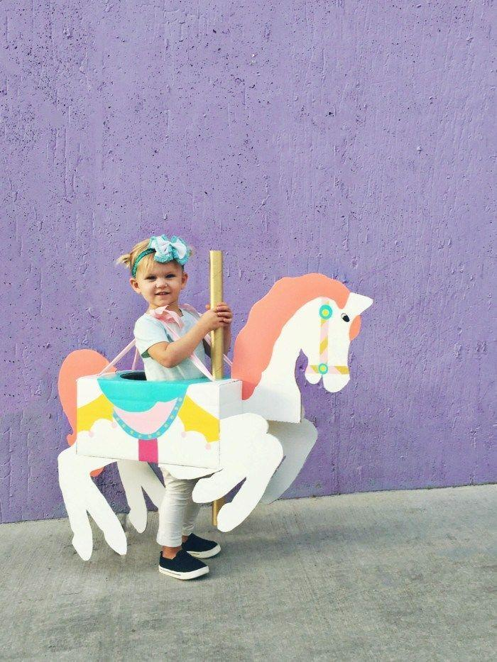"""<p>Your child will be spinning with joy in this creative and budget-friendly costume idea, which gives them a personalized carousel horse to ride all night long. </p><p><strong>Get the tutorial at <a href=""""http://www.ajoyfulriot.com/carousel-horse-costume-diy/"""" rel=""""nofollow noopener"""" target=""""_blank"""" data-ylk=""""slk:A Joyful Riot"""" class=""""link rapid-noclick-resp"""">A Joyful Riot</a>. </strong></p><p><a class=""""link rapid-noclick-resp"""" href=""""https://www.amazon.com/Apple-Barrel-Acrylic-PROMOABII-Selling/dp/B00ATJSD8S?tag=syn-yahoo-20&ascsubtag=%5Bartid%7C10050.g.29402076%5Bsrc%7Cyahoo-us"""" rel=""""nofollow noopener"""" target=""""_blank"""" data-ylk=""""slk:SHOP CRAFT PAINT"""">SHOP CRAFT PAINT</a></p>"""