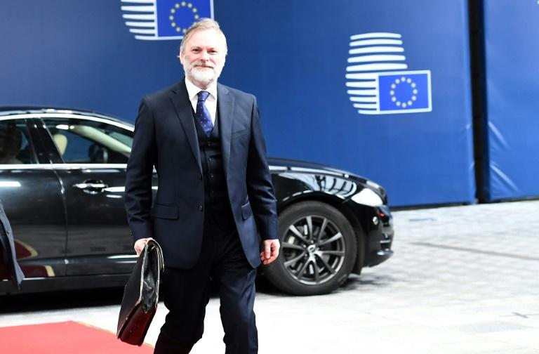Britain's ambassador to the EU Tim Barrow arrives to deliver Brexit letter to EU president Donald Tusk