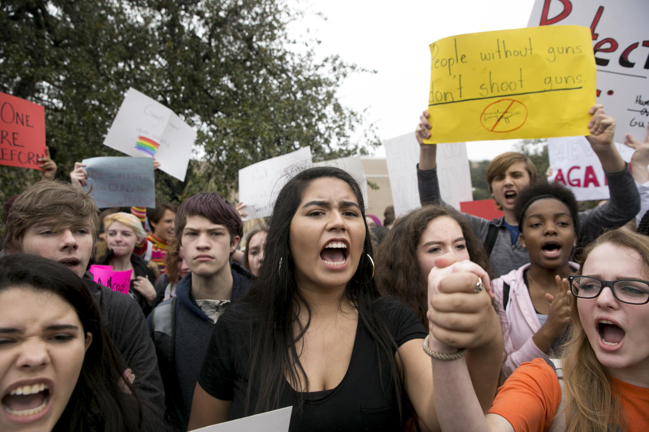 <p>Madison Flores, 17, middle, participates in a walkout and demonstration for gun control at Anderson High School in Austin, Texas, on Friday Feb. 23, 2018. (Photo: Jay Janner/Austin American-Statesman via AP) </p>