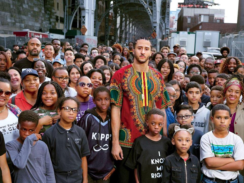 """Colin Kaepernick, center, has been named """"Citizen of the Year"""" by GQ magazine. (GQ)"""