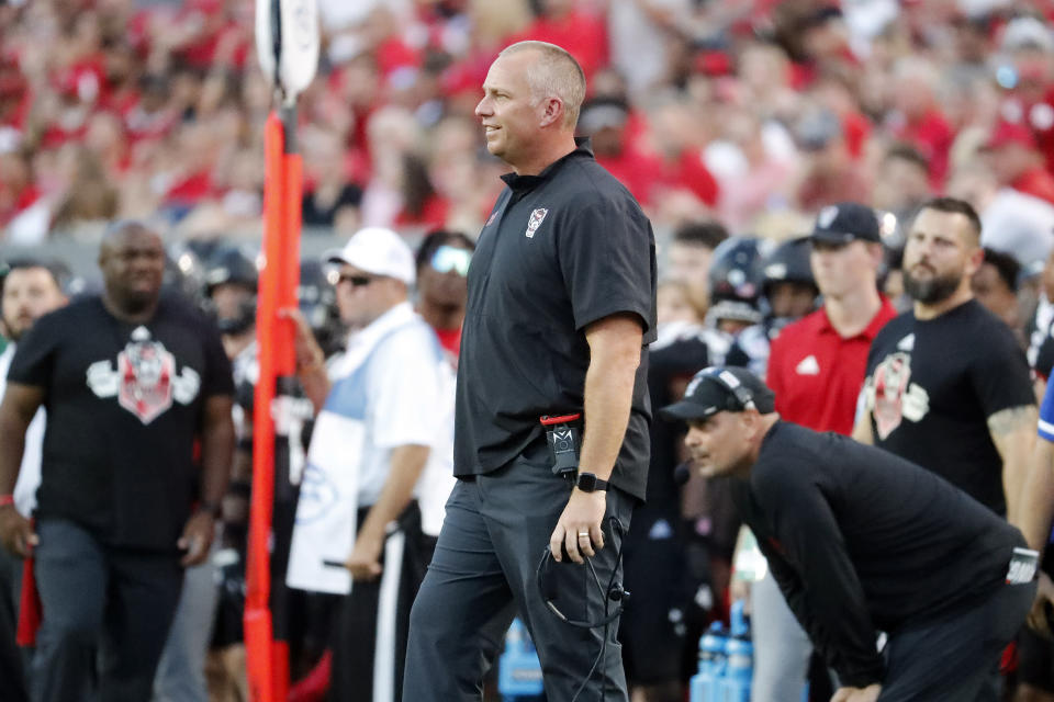 North Carolina State head coach Dave Doeren disputes a penalty with officials during the first half of an NCAA college football game against Louisiana Tech in Raleigh, N.C., Saturday, Oct. 2, 2021. (AP Photo/Karl B DeBlaker)
