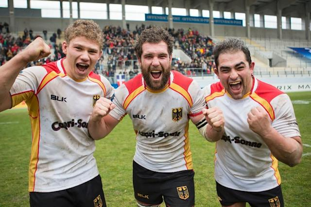 German players (L-R) Eric Marks, Jarrid Els and Samy Fuechsel celebrate after the victory in Rugby Europe Championship match Germany v Romania on February 11, 2017 in Offenbach (AFP Photo/Jürgen Keßler)