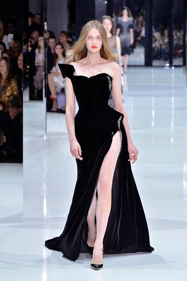 <p>Model wears a svelte one-shoulder black velvet gown with silver embellishments from the Ralph & Russo SS18 Haute Couture show. (Photo: Getty Images) </p>