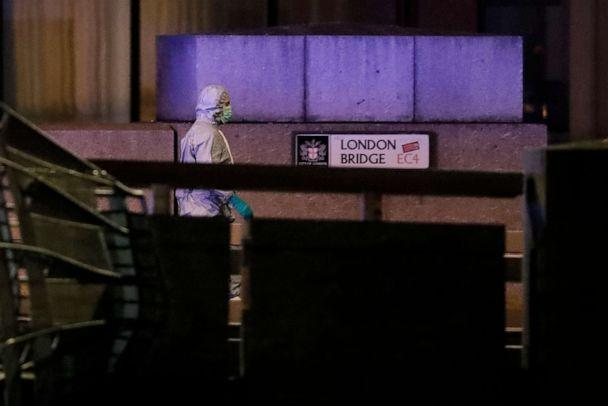 PHOTO: A police forensic officer walks by a sign on London Bridge following an incident in London, Nov. 29, 2019. (Matt Dunham/AP)
