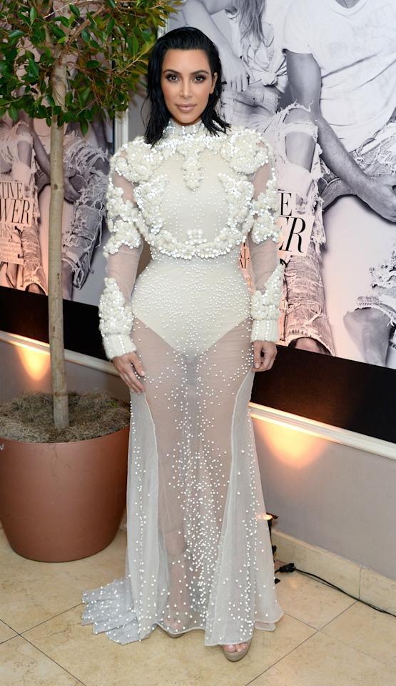 <div>Kim showed how it's done in a bridal-inspired Givenchy couture gown.<br /><i>[Photo: Getty]</i> </div>