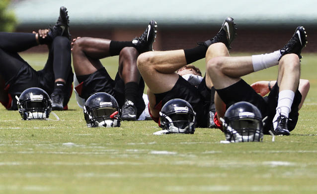 <p>Atlanta Falcons players stretch during the team's NFL football rookie minicamp in Flowery Branch, Ga., May 12, 2017. (Photo: David Goldman/AP) </p>