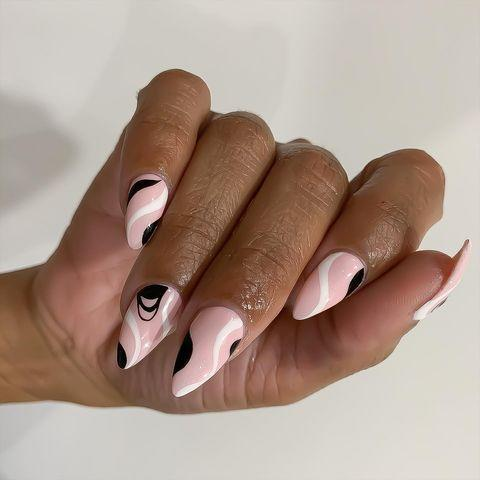 """<p>What <strong>pairs perfectly with a sharp, pointy <a href=""""https://www.cosmopolitan.com/style-beauty/beauty/g10223890/stiletto-nails-art-design/"""" rel=""""nofollow noopener"""" target=""""_blank"""" data-ylk=""""slk:stiletto nail shape"""" class=""""link rapid-noclick-resp"""">stiletto nail shape</a></strong>? A soft, curvy design over the top of subtle <a href=""""https://www.cosmopolitan.com/style-beauty/beauty/g28495772/pink-nail-polish-colors/"""" rel=""""nofollow noopener"""" target=""""_blank"""" data-ylk=""""slk:pink polish"""" class=""""link rapid-noclick-resp"""">pink polish</a>. Remember, it's all about ~balance~.</p><p><a href=""""https://www.instagram.com/p/CHqRX7yDXWK/?utm_source=ig_embed&utm_campaign=loading"""" rel=""""nofollow noopener"""" target=""""_blank"""" data-ylk=""""slk:See the original post on Instagram"""" class=""""link rapid-noclick-resp"""">See the original post on Instagram</a></p>"""