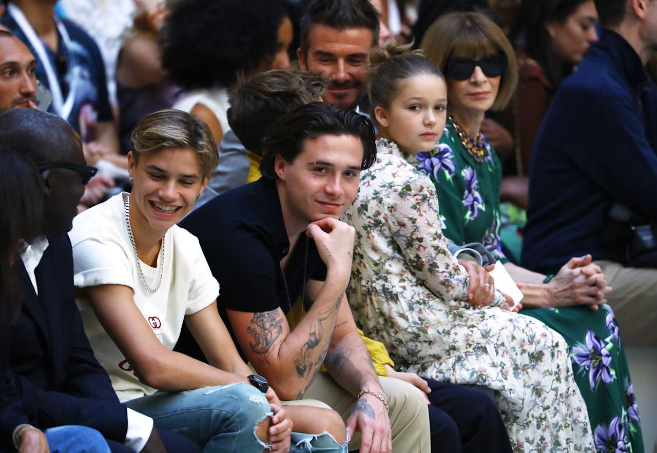 Edward Enninful, Romeo Beckham, Brookyln Beckham, Cruz Beckham, David Beckham, Harper Beckham and Anna Wintour sit front row [Photo: Getty]