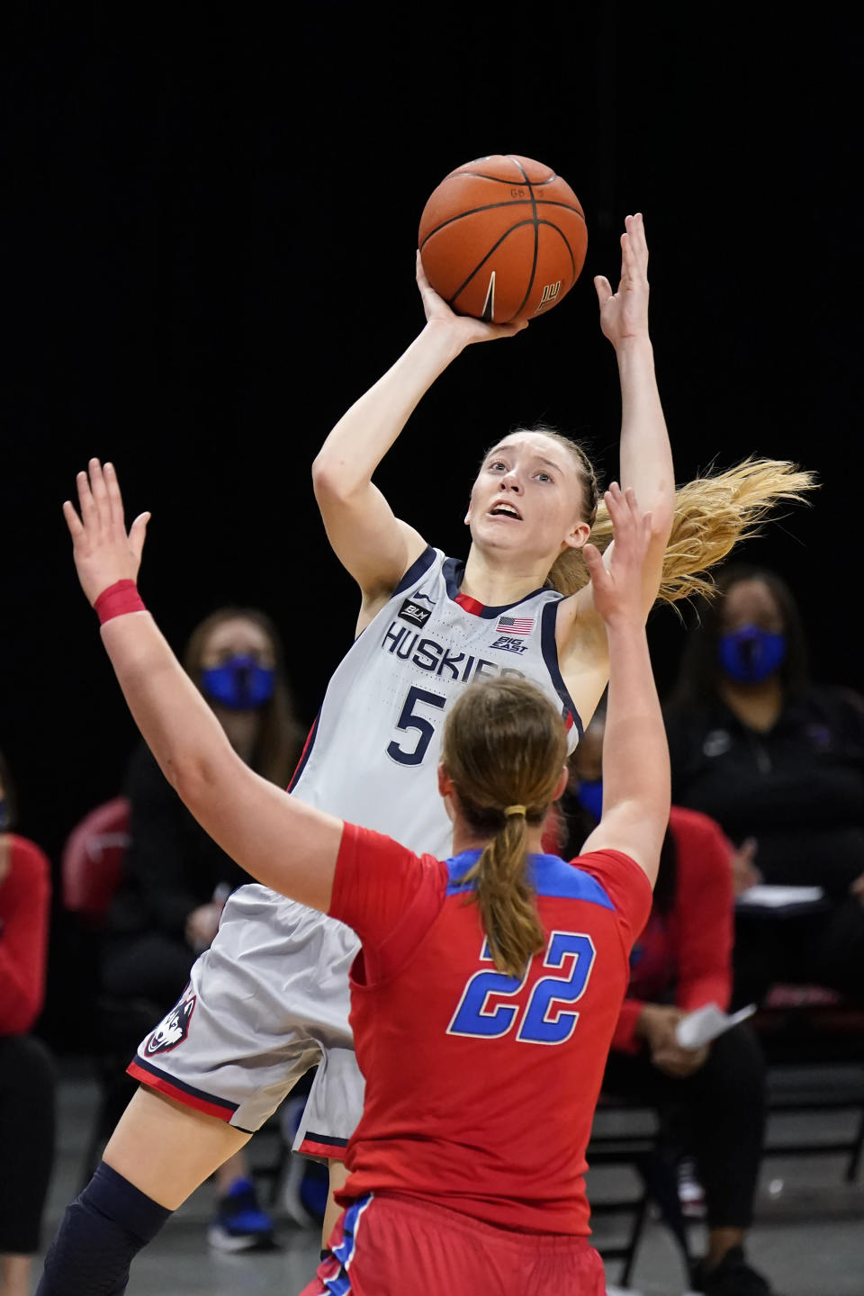 Connecticut's Paige Bueckers (5) shoots over DePaul's Jorie Allen during the first half of an NCAA college basketball game Sunday, Jan. 31, 2021, in Chicago. (AP Photo/Charles Rex Arbogast)