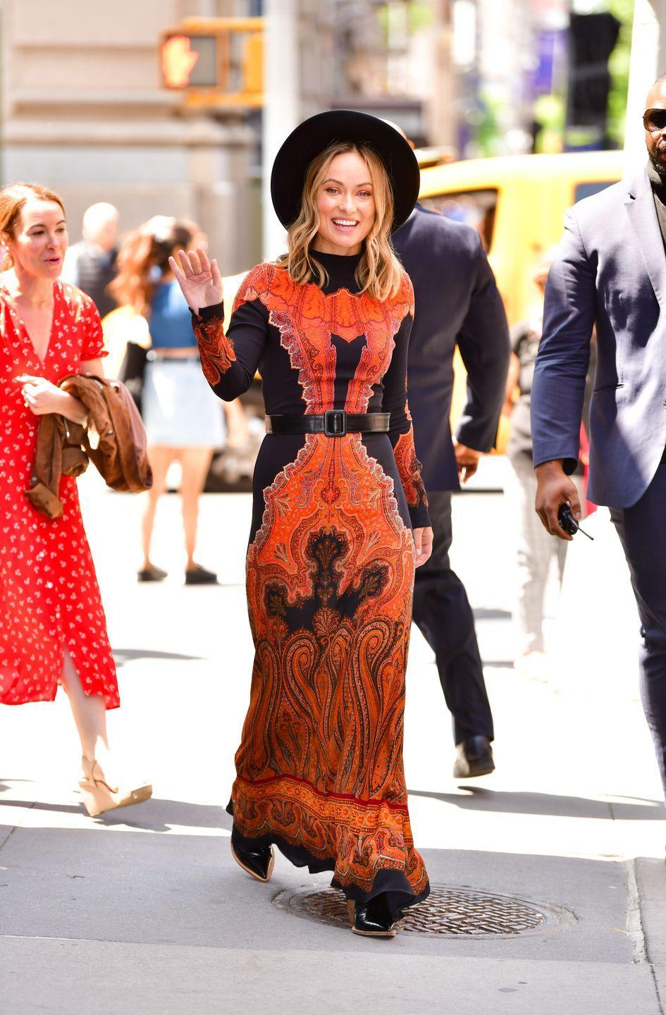 "<p>Wilde wore a 1970s-inspired <a href=""https://www.thezoereport.com/p/olivia-wildes-maxi-dress-is-the-one-step-outfit-your-spring-lineup-needs-17892770"" rel=""nofollow noopener"" target=""_blank"" data-ylk=""slk:paisley dress"" class=""link rapid-noclick-resp"">paisley dress</a> with a fedora and boots for the NYC event. </p>"