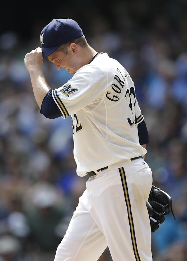 Milwaukee Brewers starting pitcher Tom Gorzelanny walks back to the mound after giving up a home run to the St. Louis Cardinals during the second inning of a baseball game Wednesday, Aug. 21, 2013, in Milwaukee. The Cardinals scored six runs in the inning. (AP Photo/Jeffrey Phelps)