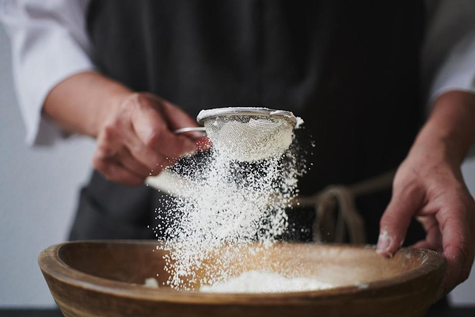 """<p>After you open a large bag of flour for your <a href=""""https://www.thedailymeal.com/cook/genius-hacks-amateur-baker?referrer=yahoo&category=beauty_food&include_utm=1&utm_medium=referral&utm_source=yahoo&utm_campaign=feed"""" rel=""""nofollow noopener"""" target=""""_blank"""" data-ylk=""""slk:baking adventures"""" class=""""link rapid-noclick-resp"""">baking adventures</a>, what do you do with the rest of it? If you simply crumple down the top and stick it back in the pantry, you're making a mistake. Tiny bugs can infiltrate your baking supplies and hide in the flour. The little black critters can be tough to detect. Left exposed to air, flour can also oxidize and go bad faster. Instead, make sure your flour is stored in a container with a sealable and airtight lid.</p>"""