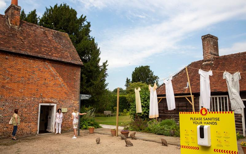 Period dresses hang on a washing line at the re-opened Jane Austen's House, in Chawton, Hampshire - Heathcliff O'Malley