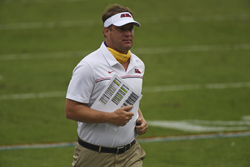 Mississippi head coach Lane Kiffin runs off the field after the first half of an NCAA college football game between Mississippi and Florida in Oxford, Miss., Saturday, Sept. 26, 2020. (AP Photo/Thomas Graning)