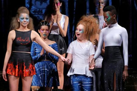 Australian model and designer Madeline Stuart, who has Down syndrome, acknowledges attendees after presenting creations from her label 21 Reasons Why By Madeline Stuart during New York Fashion Week in Manhattan, New York, U.S.