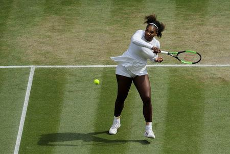 Tennis - Wimbledon - All England Lawn Tennis and Croquet Club, London, Britain - July 12, 2018 Serena Williams of the U.S. in action during her semi final match against Germany's Julia Goerges Ben Curtis/Pool via Reuters
