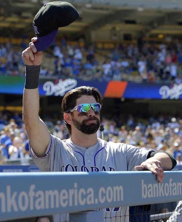 Colorado Rockies first baseman Todd Helton acknowledges fans after watching a video tribute to him prior to the Rockies' baseball game against the Los Angeles Dodgers, Sunday, Sept. 29, 2013, in Los Angeles. Helton is retiring after the season. (AP Photo/Mark J. Terrill)