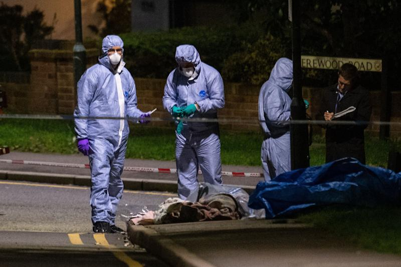 Police forensics officers at the scene of a fatal stabbing on Barnehurst Avenue, in Bexley, south east London. (Photo: PA Wire/PA Images)