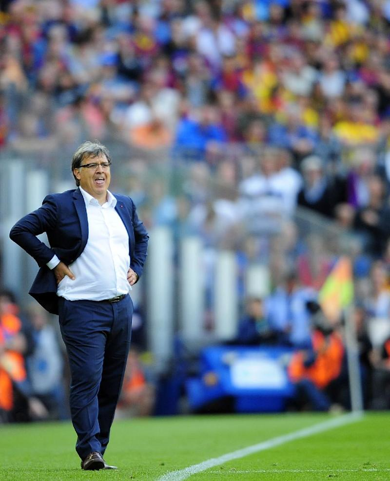 Argentina hires Gerardo Martino as coach