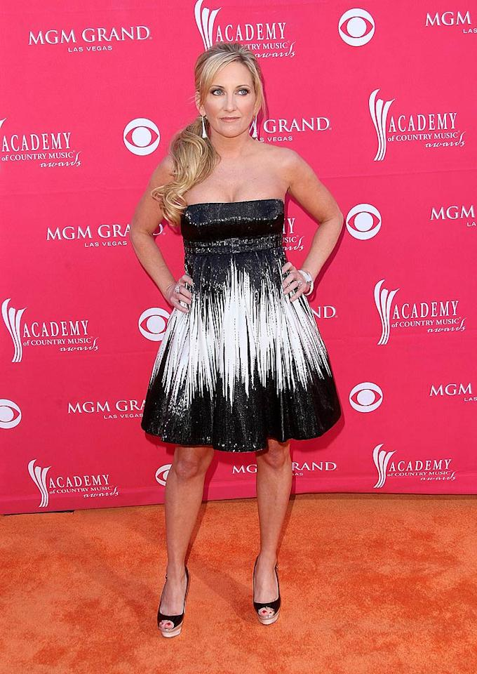 "Lee Ann Womack didn't seem thrilled with her decision to don this sparkling black and white strapless frock, and neither were we. Jason Merritt/<a href=""http://www.gettyimages.com/"" target=""new"">GettyImages.com</a> - April 5, 2009"