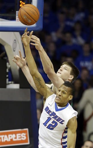 Notre Dame forward Jack Cooley, top, and DePaul forward Cleveland Melvin battle for a rebound during the first half of an NCAA college basketball game in Rosemont, Ill., on Saturday, Feb. 2, 2013. (AP Photo/Nam Y. Huh)