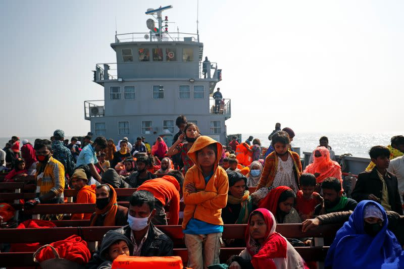 Rohingya refugees sit on a navy vessel carrying them to Bhasan Char island in Noakhali district, Bangladesh