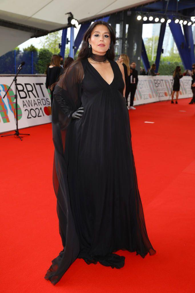 <p>The pregnant star wore Valentino. complete with diaphanous scarf and leather gloves. </p>