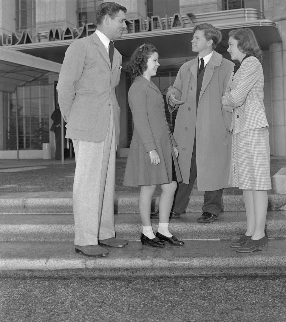 <p>Judy continued her film career at MGM. Here, she, Mickey Rooney, and Clark Gable are seen greeting Shirley Temple, newly signed by MGM. </p>
