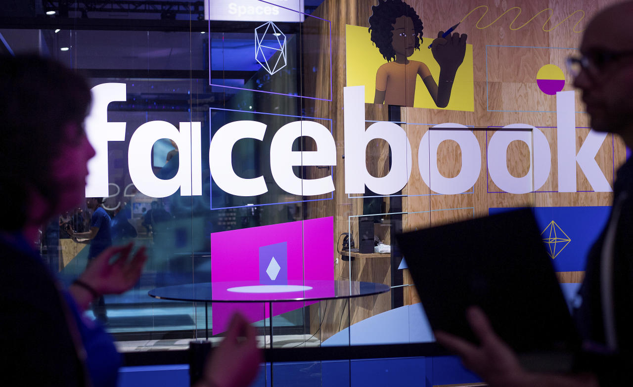 <p> FILE - In this April 18, 2017, file photo, conference workers speak in front of a demo booth at Facebook's annual F8 developer conference, in San Jose, Calif. P Facebook is facing the most serious crisis in its 14-year history as it deals with fallout from a major leak of user data to political consultants associated with the 2016 Trump campaign. (AP Photo/Noah Berger, File) </p>