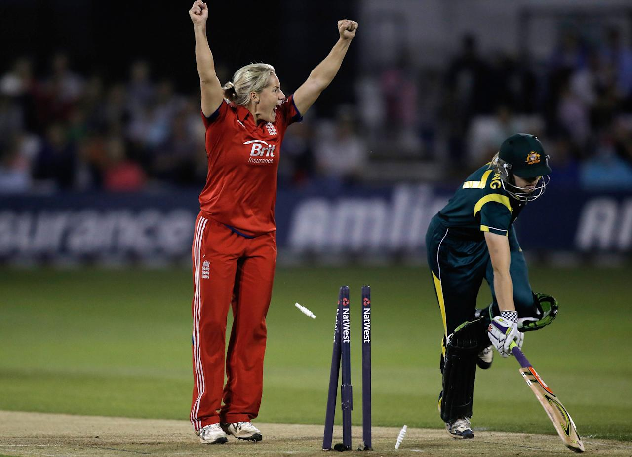 CHELMSFORD, ENGLAND - AUGUST 27:  Meg Lanning of Australia is run out as Katherine Brunt of England celebrates during the first NatWest T20 match between England and Australia at the Ford County Ground on August 27, 2013 in Chelmsford, England.  (Photo by Harry Engels/Getty Images)