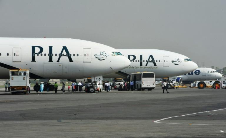 Pakistan's PIA has been barred from operating in the European Union after the state-run carrier grounded nearly a third of its pilots for holding fake or dubious licences (AFP Photo/FAROOQ NAEEM)