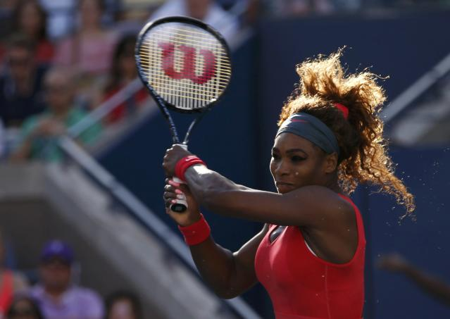Serena Williams hits a return to Victoria Azarenka of Belarus during their women's singles final match at the U.S. Open tennis championships in New York September 8, 2013. REUTERS/Mike Segar (UNITED STATES - Tags: SPORT TENNIS)