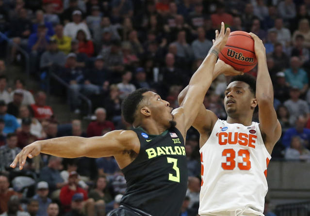 Syracuse forward Elijah Hughes (33) shoots as Baylor guard King McClure (3) defends during the first half of a first-round game in the NCAA mens college basketball tournament Thursday, March 21, 2019, in Salt Lake City. (AP Photo/Rick Bowmer)