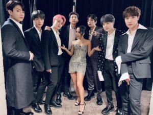 BTS Members and Becky G at an award ceremony.