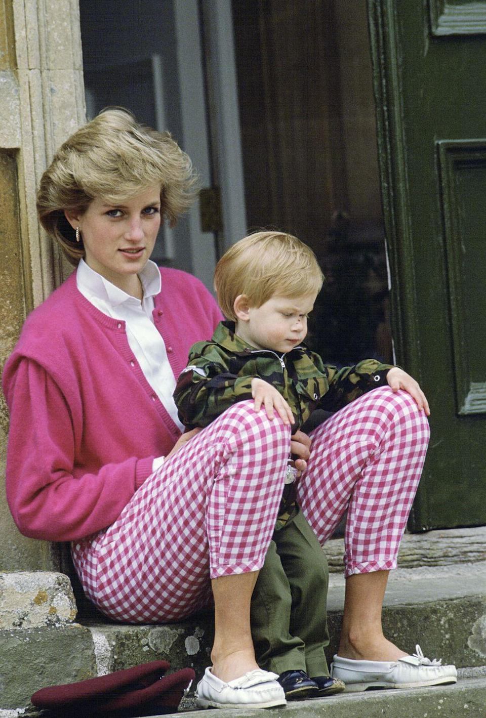 <p>Another vote in favor of pink plaid? This classic look Diana wore while playing with Prince Harry at Highgrove in 1986.</p>