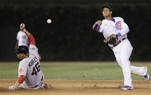 Chicago Cubs shortstop Starlin Castro, right, throws to first after forcing out Boston Red Sox's Franklin Morales during the fifth inning of an interleague baseball game in Chicago, Sunday, June 17, 2012. Scott Podsednik was out at first. (AP Photo/Nam Y. Huh)