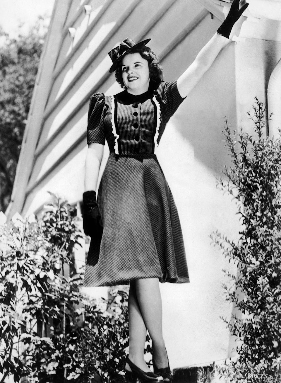 """Garland wears a dress she wore in the film """"Babes in Arms,"""" circa 1940."""