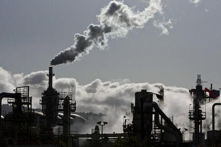 Smoke is released into the sky at the ConocoPhillips oil refinery in San Pedro