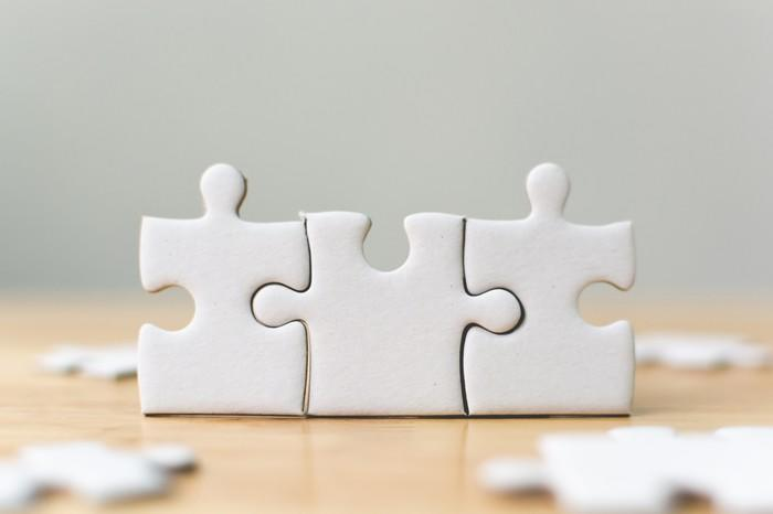 Three connected jigsaw puzzle pieces.