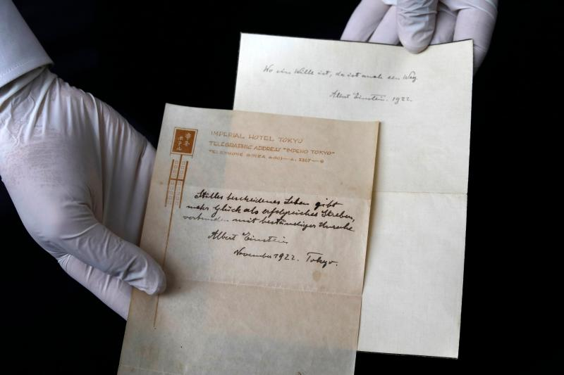 The two notes written by Albert Einstein in 1922. (MENAHEM KAHANA via Getty Images)