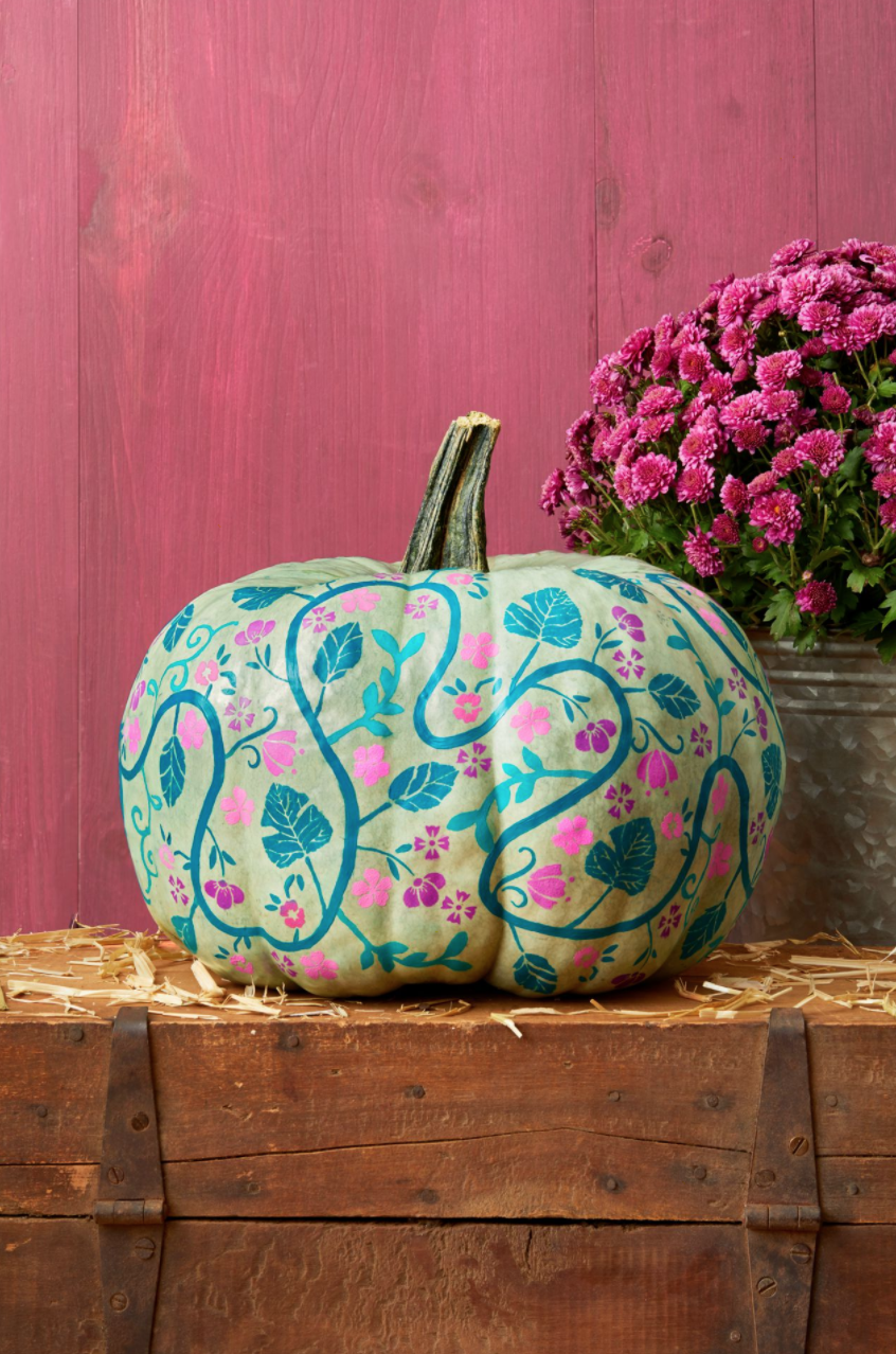 """<p>Bring your pumpkins back to their roots—literally!—with this inspired vine design. A green-hued exterior adds to the earth-centric theme. </p><p><strong>Make the pumpkins: </strong></p><p>With a thin paintbrush, paint a looping vine around a green pumpkin. Let dry.</p><p>Cut out and tape a large leaf stencil to the pumpkin.</p><p>Using a foam pouncer, lightly dab craft paint on to the pumpkin to fill in the stencil. Let dry, then remove the stencil. Use it several more times around the pumpkin to fill in spaces between the vines.</p><p>Repeat steps 2 and 3 with other stencils, working from bigger stencils to smaller ones, until you've filled in most of the pumpkin.</p><p><a class=""""link rapid-noclick-resp"""" href=""""https://go.redirectingat.com?id=74968X1596630&url=https%3A%2F%2Fwww.walmart.com%2Fip%2FFolkArt-5070E-Acrylic-Craft-Paint-Set-Matte-Finish-Festival-Set-of-12-24-fl-oz%2F52620447&sref=https%3A%2F%2Fwww.thepioneerwoman.com%2Fholidays-celebrations%2Fg32894423%2Foutdoor-halloween-decorations%2F"""" rel=""""nofollow noopener"""" target=""""_blank"""" data-ylk=""""slk:SHOP CRAFT PAINT"""">SHOP CRAFT PAINT </a></p>"""