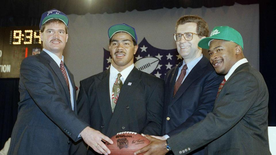 Mandatory Credit: Photo by Mark Phillips/AP/Shutterstock (6032425a)Junior Seau, Paul Tagliabue, Blair Thomas, Jeff George NFL Commissioner Paul Tagliabue, second from right, joins first round draft picks Jeff George, far left, and Junior Seau, second from left, and Blair Thomas, at right, pose for photographers in New York after their selectionsJunior Seau, New York, USA.