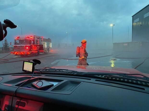 Regina firefighters tackled a fire at the Emterra Group recycling depot on Wednesday evening that they believe started in bales of recycled material.  (Regina Fire Department/Twitter - image credit)