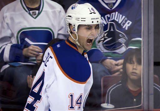 Edmonton Oilers' Jordan Eberle celebrates his goal against the Vancouver Canucks during the second period of an NHL hockey game in Vancouver, British Columbia, on Sunday, Jan. 20, 2013. (AP Photo/The Canadian Press, Darryl Dyck)