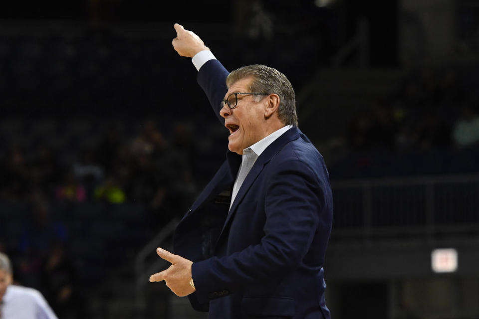 Connecticut head coach Geno Auriemma directs his team during the first half of an NCAA college basketball game against DePaul on Monday, Dec. 16, 2019. in Chicago, Ill. (AP Photo/Matt Marton)