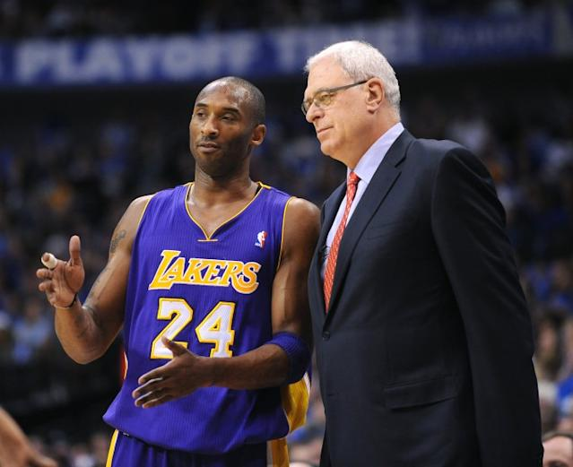 """Lakers star Kobe Bryant speaks with coach Phil Jackson during Game 4 of the 2011 Western Conference semifinals. <span class=""""copyright"""">(Wally Skalij / Los Angeles Times)</span>"""