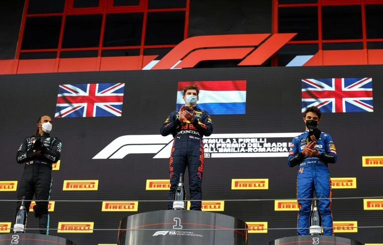 Norris (right) joins Hamilton and Verstappen (centre) on the Imola podium